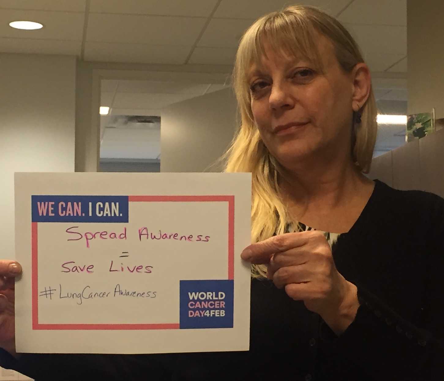 Alisa with her World Cancer Day sign