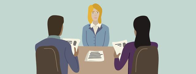 A women looking nervous during a job interview
