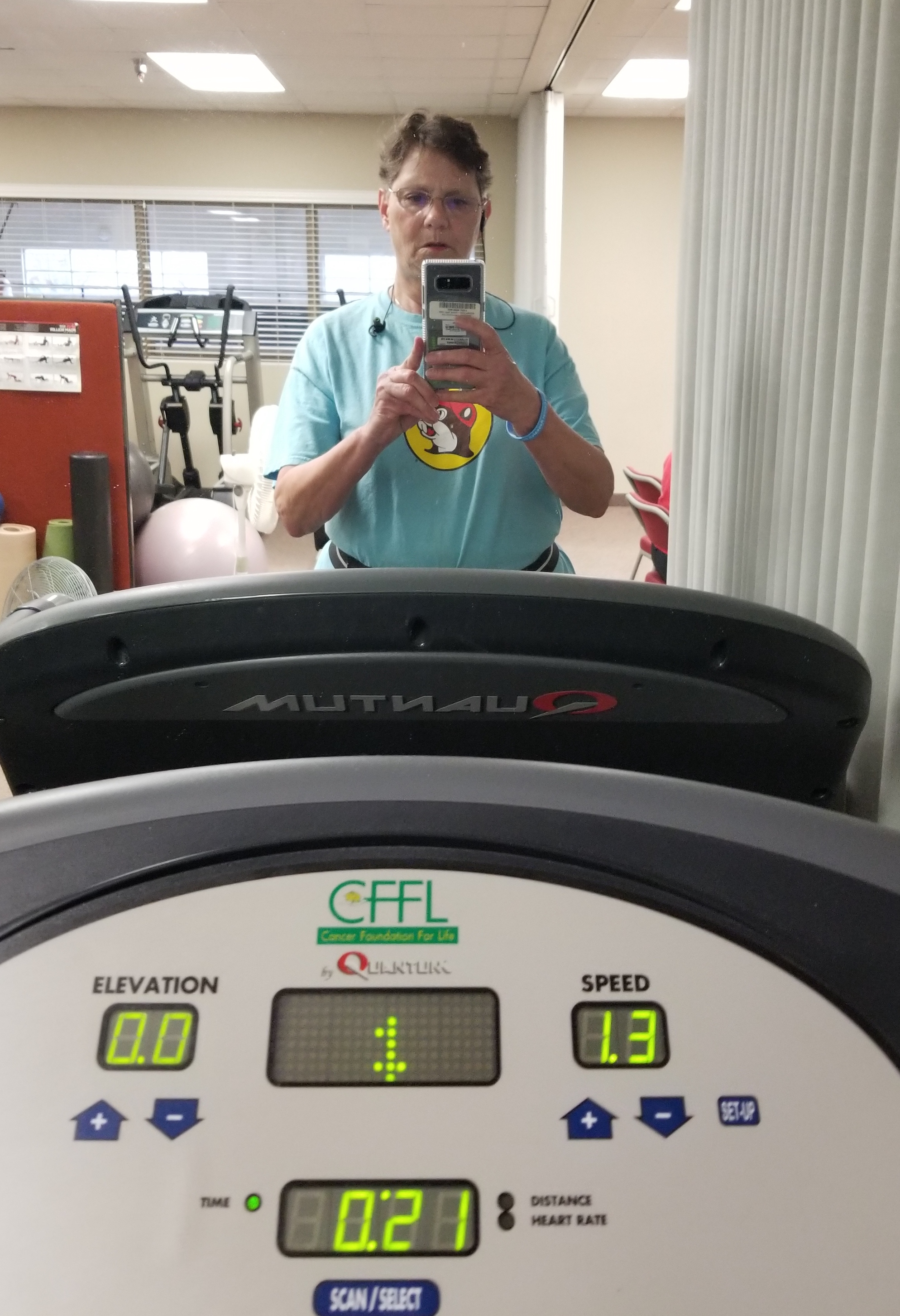 The author, Donna, exercising on the treadmill