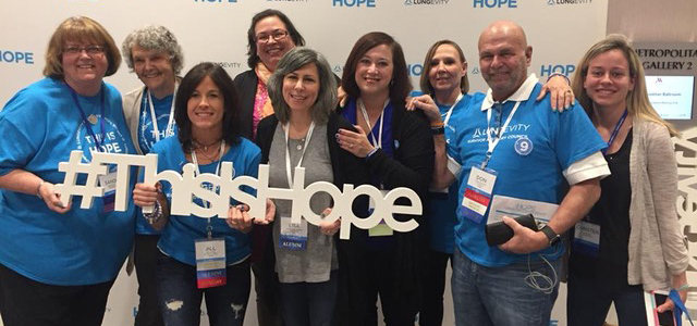 A group of lung cancer survivors together at HOPE Summit holding a sign that says 'This Is Hope'