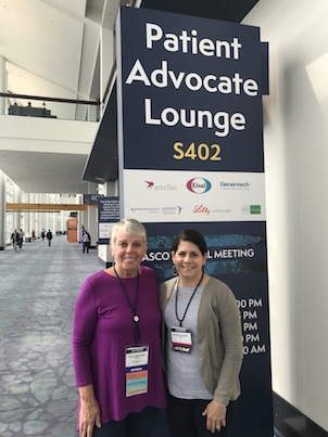 An image of the author, Dusty Donaldson, with Jeannine Salamone, ASCO's Director of Patient Advocacy at the conference.