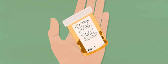 hand holding prescription bottle with pills, no expiration date