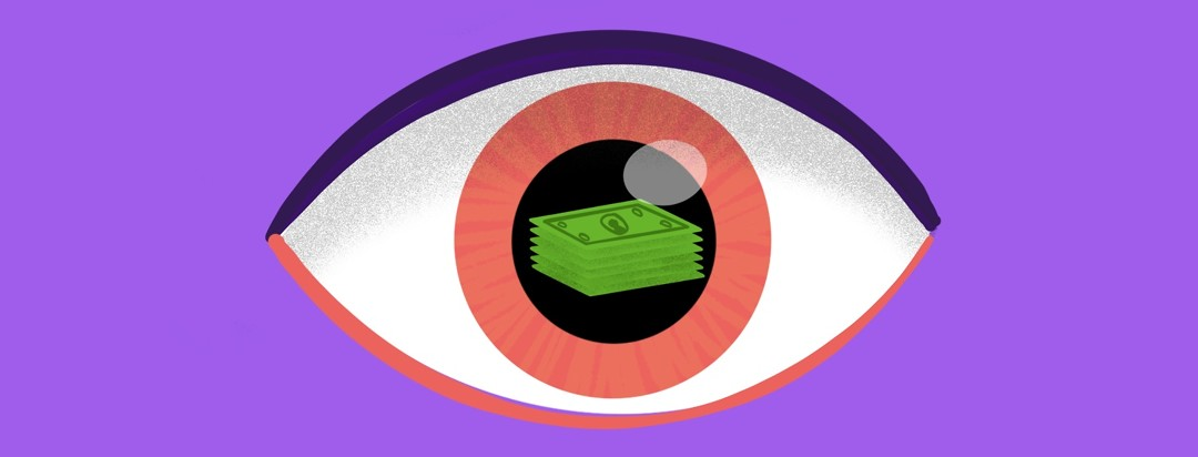 A stack of money reflected in an eye.