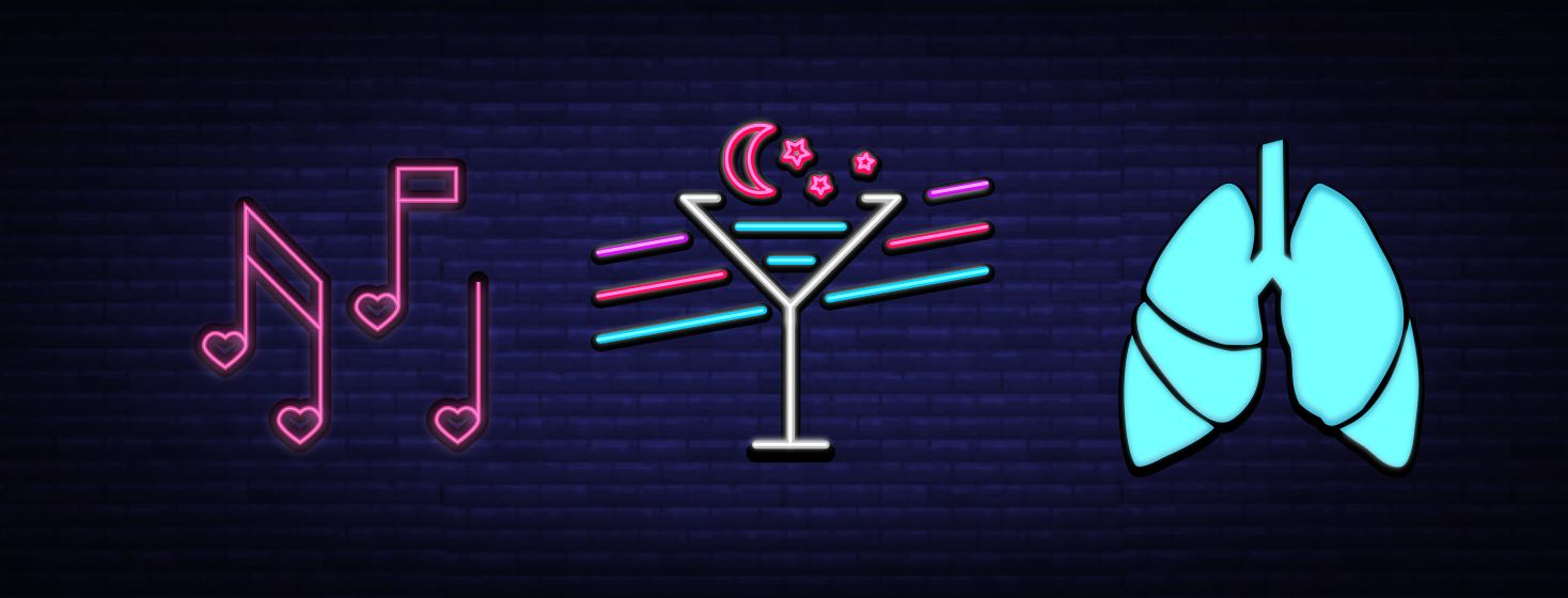 Three neon bar signs showing karaoke, cocktails, and lungs