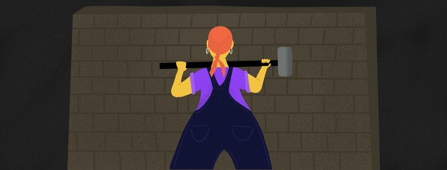 A woman stands before a wall holding a sledgehammer, ready to bust it down