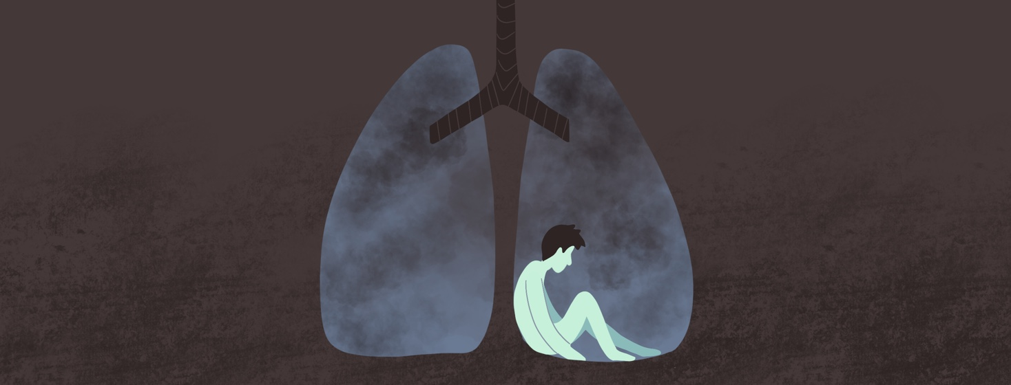 a person sits sadly inside of a smokey pair of lungs