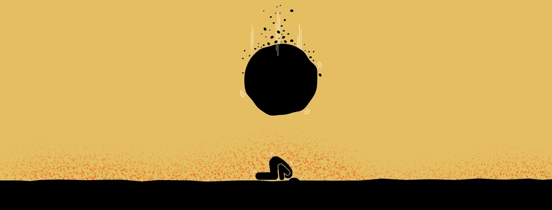 A person buried their head in the sand to avoid a falling boulder