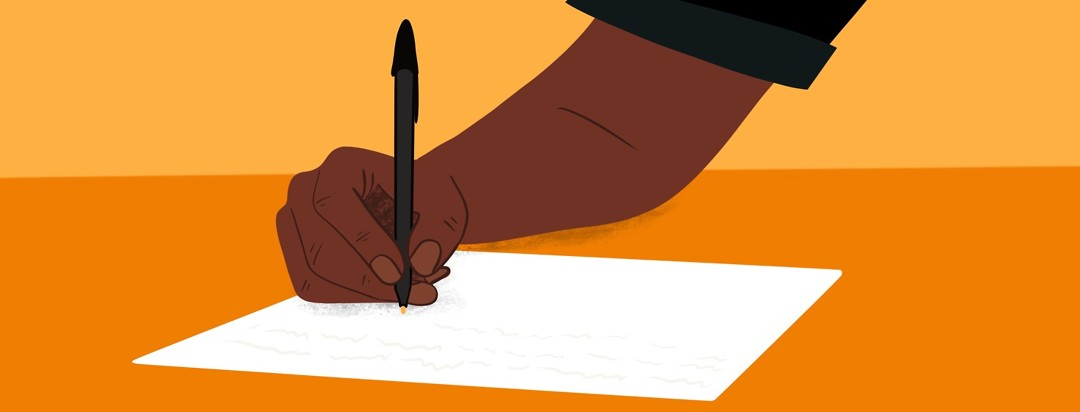 A hand writes a letter