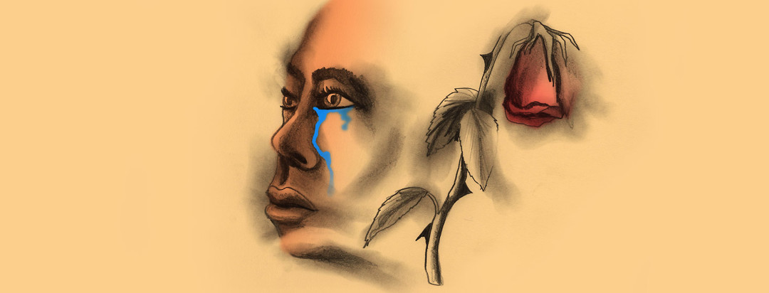 A woman cries with a wilted rose
