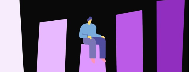 A man sits on a bar graph, where the bar he is sitting on is the lowest