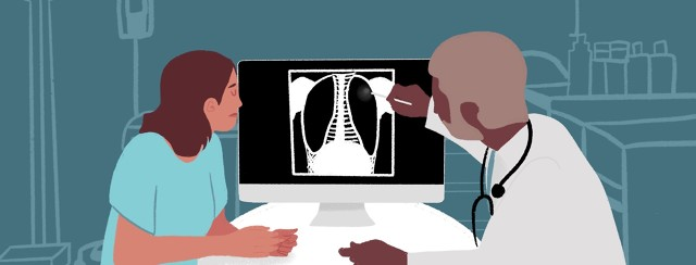 A woman and her doctor review a lung scan that shows a dark spot