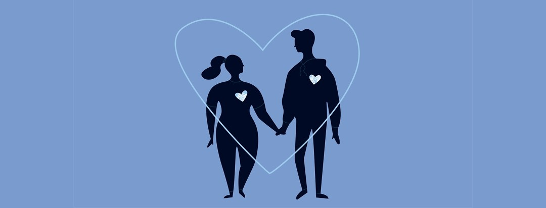 Couple holding hands with hearts around them