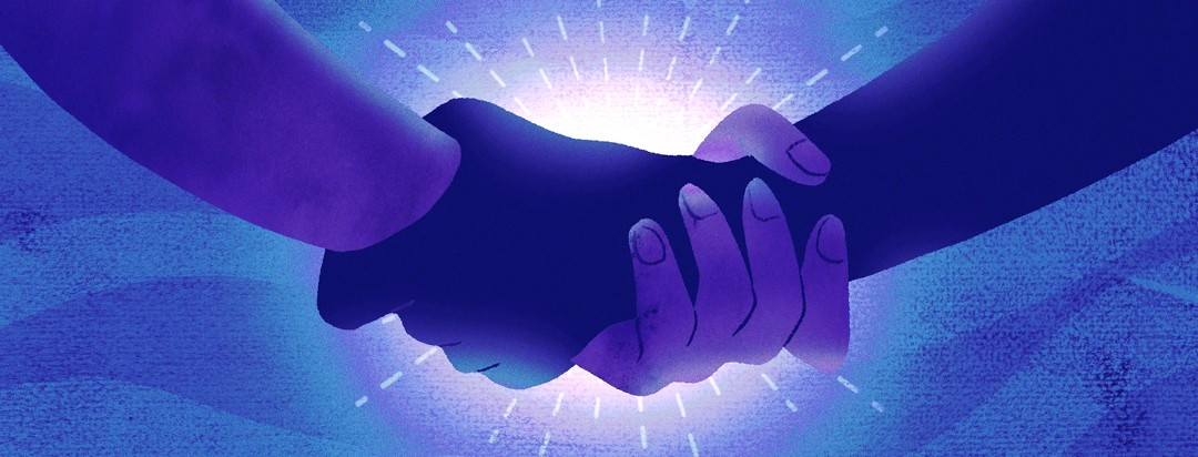 Two hands holding each other with sunlight behind them
