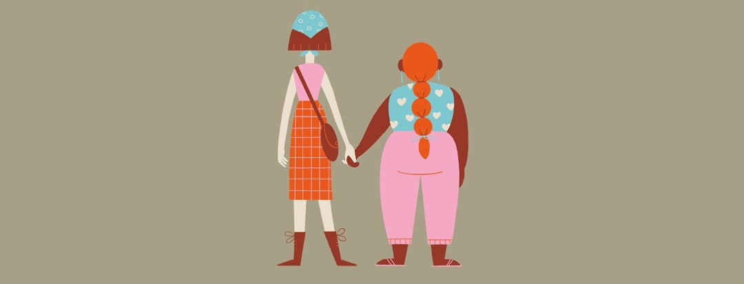 Two adult women holding hands
