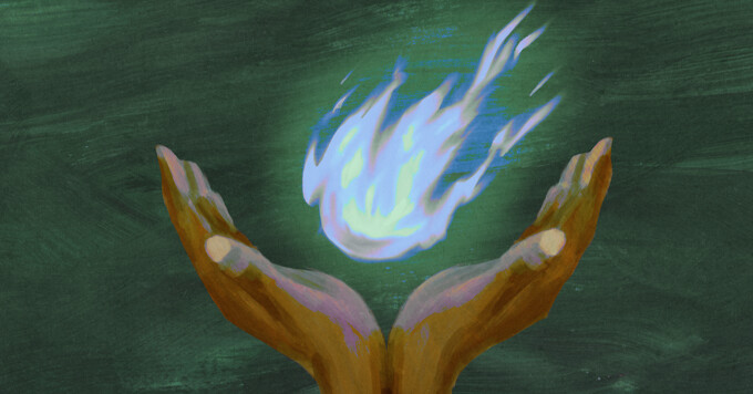 A pair of hands cupping blue flame