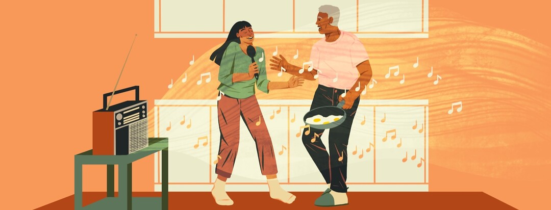 A woman and her father singing while making breakfast